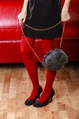 Fashion Woman Legs In Red Tights Handbag In Hand