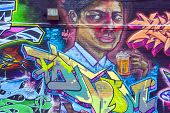 Street art Montreal beer drinker