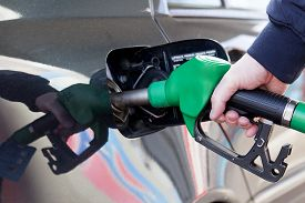 image of petrol  - man filling up car with fuel at petrol station - JPG