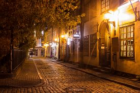 image of roof-light  - Covered with paving stones street in Old Riga Latvia at night - JPG