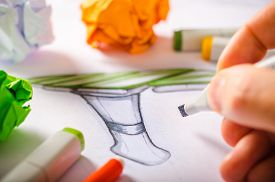 picture of sketche  - A designer drawing sketches on white paper - JPG