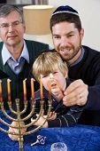 Jewish Family Lighting Chanukah Menorah