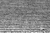 stock photo of shingles  - damaged traditional shingle roof interesting abstract real texture on old romanian church black and white - JPG