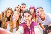 stock photo of love making  - Group of friends grimacing in front of the camera  - JPG