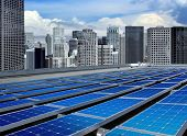 stock photo of solar battery  - solar panels on the roof of modern skyscraper - JPG
