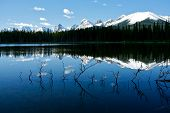 stock photo of rocky-mountains  - Calm mountain lake in the morning Kananaskis Alberta Canada - JPG