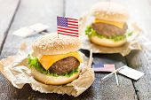 foto of beef-burger  - Mini beef burgers with American flag on wooden backgoundselective focus - JPG