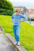 image of pullovers  - Fashion portrait of a pretty little girl of 7 years old - JPG
