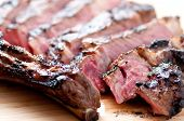 stock photo of rib eye steak  - a rare rib steak cooked to perfection on the grill