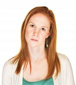 stock photo of tilt  - Serious woman with tilted head and blank stare - JPG