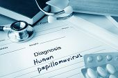 stock photo of hpv  - Diagnostic form with diagnosis Human papillomavirus HPV and pills - JPG