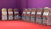 picture of coin slot  - Slot machines in the casino Interior on colorful background - JPG