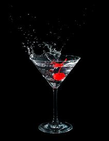 picture of black-cherry  - Maraschino cherry dropped in cocktail glass with fluid isolated on black - JPG