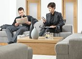 pic of anteroom  - Business people sitting on sofa at office anteroom waiting - JPG