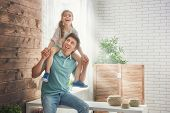 Happy loving family. Father and his daughter child girl playing together. Fathers day concept. poster