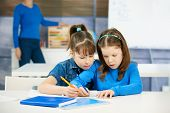 Children learning together in primary school classroom. Schoolgirls in elementary age.?