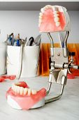 Dental background: work in clinic (operation, tooth replacement)