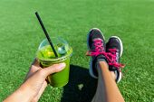 Green smoothie woman drinking plastic cup breakfast takeaway juice to go after morning run in summer poster