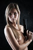 Shot of a beautiful girl holding gun.