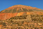 picture of ore lead  - excavated sides of open pit mine in the desert - JPG