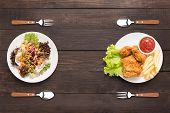 Fresh Salad And Fried Chicken And French Fries On The Wooden Background. Contrasting Food poster