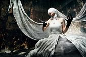 image of satanic  - Shot of a twilight girl in white dress - JPG