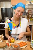 Blond girl cooking in the kitchen