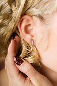 Woman's ear with diamond jewelry