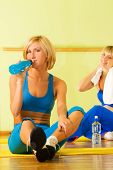 Beautiful women relaxing after fitness exercise