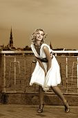 Beautiful retro stylized photo of a pretty woman that looks like Marilyn Monroe