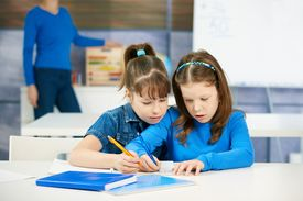 picture of school child  - Children learning together in primary school classroom - JPG