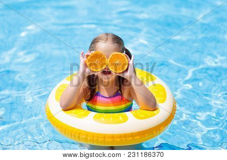 poster of Child In Swimming Pool. Kid Eating Orange.