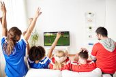 leisure, sport and entertainment concept - happy friends or football fans watching soccer game on tv poster