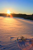 Winter sunset. Frozen lake