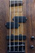 Body Of A Classic Bass Guitar.electric Bass Guitar Element.guitar Neck Closeup.chord.selective Focus poster