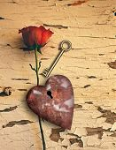 Surrealism. Red rose and rusted heart with keyhole. Golden key. 3D rendering poster