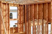 New Construction Home Framing New Build With Wooden Truss, Post And Beam Framework. poster