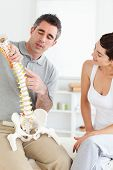 Chiropractor Explaining The Spine To A Woman
