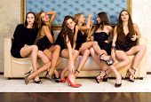 stock photo of night gown  - Six beautiful sexy models are sitting on the sofa - JPG
