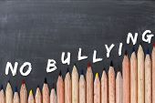 No Bullying Text On Chalkboard With Colorful Pencils As Border poster