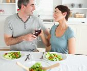 Close Up Of A Cute Couple Toasting With Redwine