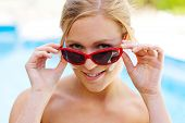 Woman with sunglasses and sun cream