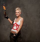 Punk girl with a Molotov cocktail.
