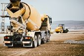 Industrial Cement Truck On Highway Construction Site. Heavy Duty Machinery At Work On Construction S poster