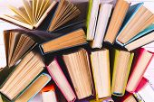 Open Book, Hardback Books On Bright Colorful Background. poster