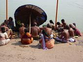 Hindu Pilgrims And Holy Men Gather On The Ganges Ghats