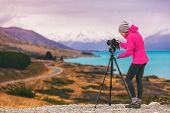 Travel photographer woman shooting nature photography mountain landscape at Peters lookout, New Zea poster
