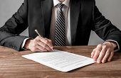 Close Up Business Man Signing Contract Making A Deal, Business And Success Concept poster