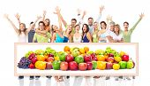 Group of happy people with fruits. Over white background.