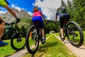 Mountain biking family with bikes on track, Cortina dAmpezzo, Dolomites, Italy poster